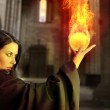 Young beautiful girl with fire sphere, sorcerer — Stock Photo