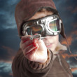 Boy dressed up in pilot outfit, jacket, hat and glasses. — Stock Photo