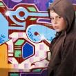 Stock Photo: Young boy before graffiti