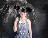 Beautiful girl with umbrella in a depressed state — Stock Photo