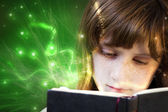Young beautiful girl reading a book, fantasy reading — Stock Photo