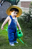 Little baby gardener concentrate in his work — Stock Photo