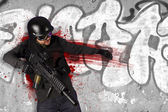 Assault troops, soldier wounded in action, grafitti background — Stock Photo