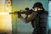 Street Assault, riot police firing his submachine gun — Stock Photo