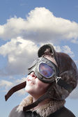 Boy dressed up in pilot outfit, jacket, hat and glasses. — Fotografia Stock