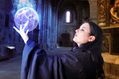 Young beautiful girl with energy sphere, sorcerer — Stock Photo