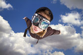 Boy flying, daydreaming he is a pilot — Stock Photo
