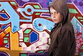 Young boy before graffiti — Stock Photo