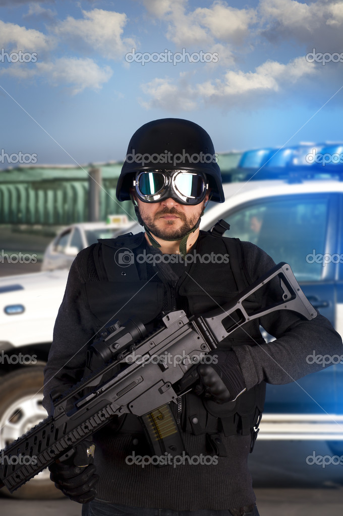 Armed man in protective cask with machine gun. Police  Stock Photo #8664792