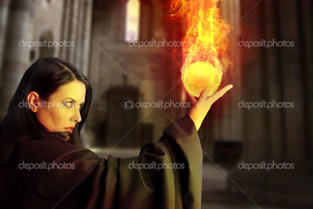 Young beautiful girl with fire sphere, sorcerer  Stock Photo #8667653