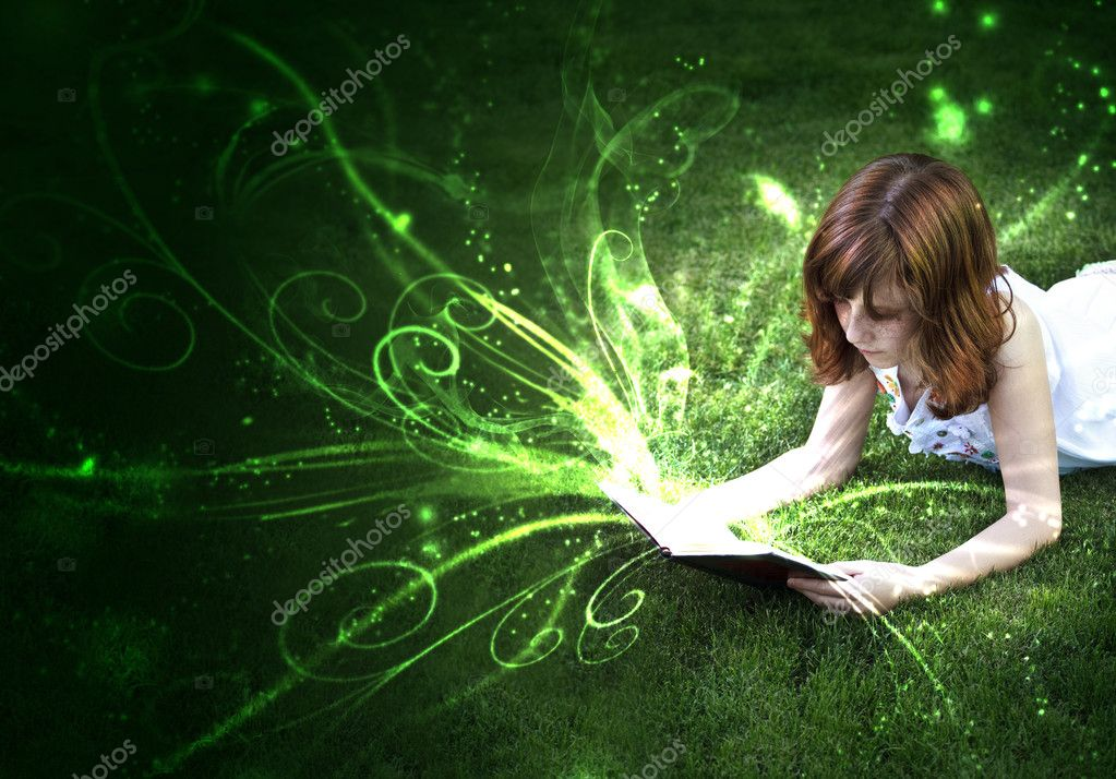 Young beautiful girl reading a book outdoor — Stock Photo #8668585