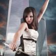 Beautiful girl in a business center with a sword. Angry — Stock Photo