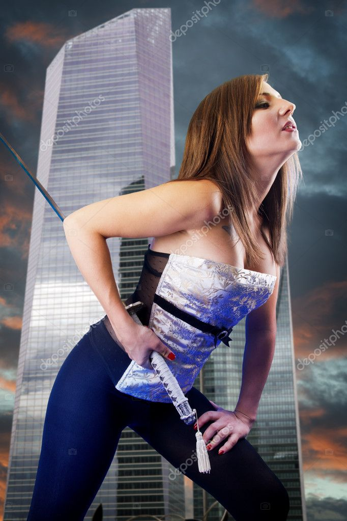 Beautiful girl in a business center with a katana. Angry  Stock Photo #8671415