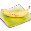 Banana on colorful plate - Stock Photo