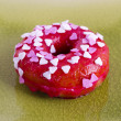 Colorful donut on a plate - Stock Photo