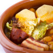 Madrid stew on earthenware pot, spanish food - Stok fotoğraf