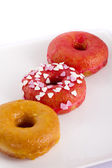 Colorful donut on a plate — Stock Photo