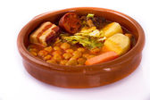Madrid stew on earthenware pot, spanish food — Stock Photo