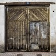 Old door in old street of shops - Stock Photo