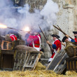 Soldiers firing during the re-enactment of the War of Succession — Stock Photo