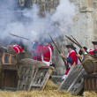 Defence and attack the castle during the re-enactment of the War — Stock Photo