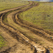 Country road with mud, ruts - Stock Photo