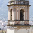 Belltower and temple bells in Denia, Spain - 图库照片
