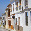 Spanish street with typical houses in Denia, Spain - Stockfoto