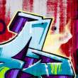 Street art, segment of an urban grafitti on wall — Stock Photo
