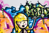 Color cartoons, segment of an urban grafitti on wall — Stock Photo