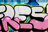 Typography and color lines, segment of an urban grafitti on wall — Stock Photo
