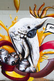 Color cartoons, segment of an urban grafitti on wall — Stock Photo