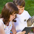 Portrait of cute kids reading books in natural environment — Stock Photo #8775747
