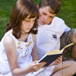Portrait of cute kids reading books  in natural environment — Stock Photo