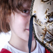 Stock Photo: Girl wearing venicean mask