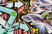 Street art, segment of an urban grafitti on wall — Stock Photo
