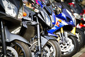 Modern and vintage motorbikes — Stock Photo