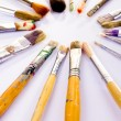 Used paint brushes of different colors - Stock Photo