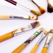Used paint brushes of different colors — Stock Photo