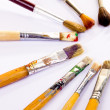 Used paint brushes of different colors — Stock Photo #8791975