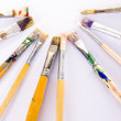 Used paint brushes of different colors — Stock Photo #8792159
