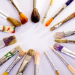Stock Photo: Used paint brushes of different colors