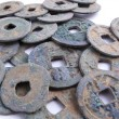 Picture of a bulk lot of old chinese coins — Stock Photo
