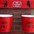Two fire buckets hanging on a wall — Stock Photo