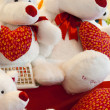 A cute white bears holding a big red Valentines Day heart - Photo