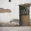 Old door in old street of shops — Stock Photo #8930959