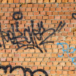 Graffiti on the bricks wall, urban picture - Stock Photo