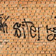 Stock Photo: Graffiti on the bricks wall, urban picture