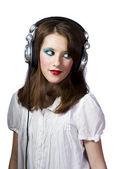 Giovane ragazza con auricolari — Foto Stock