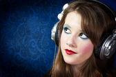 Beautiful teenager with earphones — Stock Photo